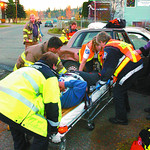 MVA strathcona and spruce3 in tuesday dave milne oct 21 02 Ambulance and Fire department paramedics remove the driver from  a car involved in a two-vehicle collision at Strathcona Avenue and ...