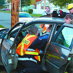 MVA strathcona and spruce1 in tuesday dave milne oct 21 02 Ambulance and Fire department paramedics attend to the driver of a car involved in a two-car collision at Strathcona Avenue and Spr ...
