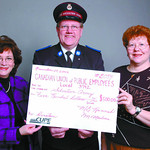 CUPE Salvation Army/Saturday Brent Braaten-Nov 29/2002  Louise Magnus, left, and Dale Grieves, right, both with CUPE 3742 present a cheque for 0 to Dennis Nore with the slavation Army. CU ...