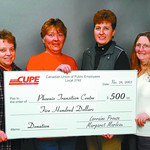 CUPE donation3 in saturday dave milne nov 28 03 CUPE Local 3742 members Lorraine Prouse, left, Karin Rolf, second from right and Margaret Marleau, far right, present Phoenix Transition Cenre ...