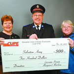 CUPE donation1 in saturday dave milne nov 28 03 CUPE Local 3742 (School Dist #57) representatives Dale Grieves, left and Linda Tull present Salvation Army Family Services Director Dennis Nor ...