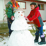 Snowman on Strathcona/Saturday Brent Braaten-Oct 22/2004  Fred Patrick and his daughter Mary Elizabeth Patrick, 7, work on the finishing touches to their snowman they made in the frontyard o ...