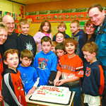 Julian Wich 0 donation in saturday dave milne jan 14 05 Eight-year-old Julian Wich cuts a cake for his Grade 3 Spruceland Elementary School  Class Friday which he and his parents, Katerin ...